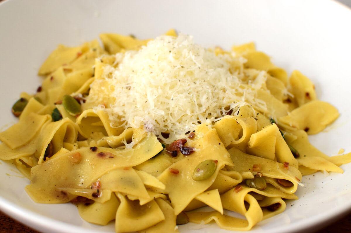 Pasta scraps with garlic, pumpkin seeds, and fresh sage.